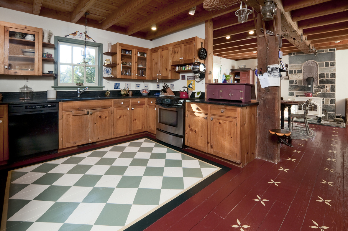 A distinctive checkerboard pattern adorns a portion of the kitchen floor; photo credit: Brian Krebs/Fred Forbes Photogroupe